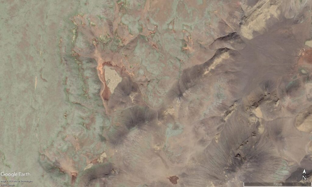 The Geldingadalur valley seen from above with Google Earth. Small valley with small mountains on most sides.