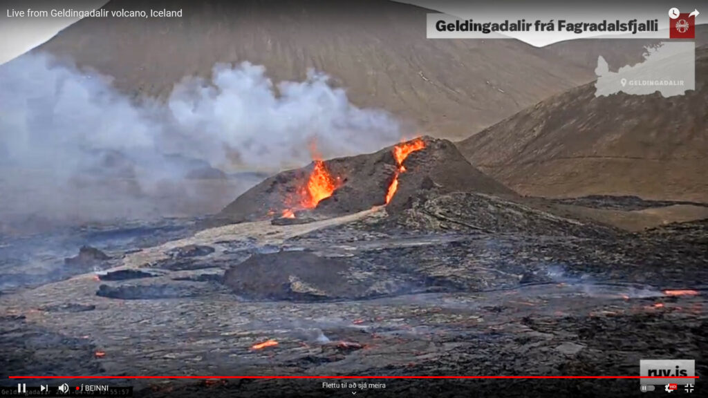 Two craters erupting. On the left side of the screen the crater there is showing splatter pattern while the one of the right side of the screen shows less spatter activity but small lava fall from the main eruption crater.