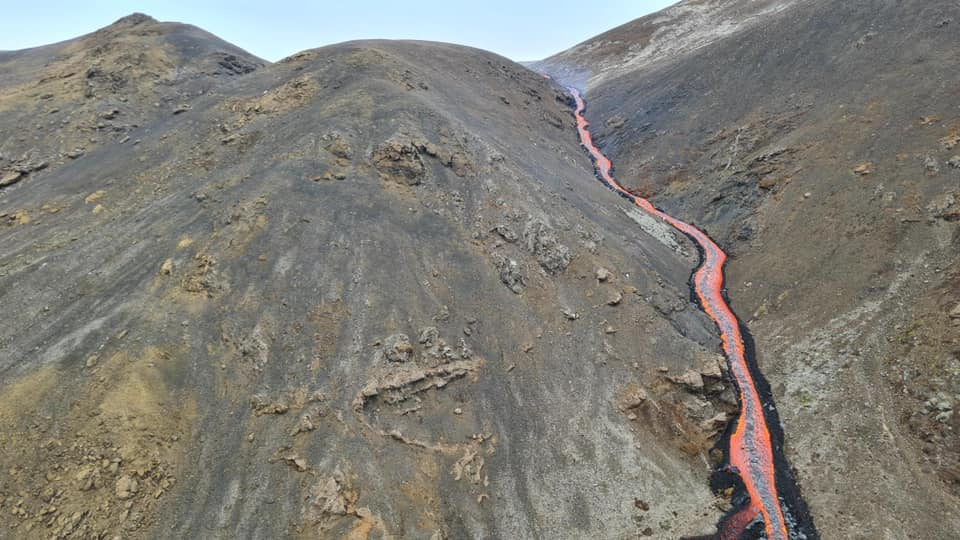 River of lava flowing downhill into a valley called Meradalir