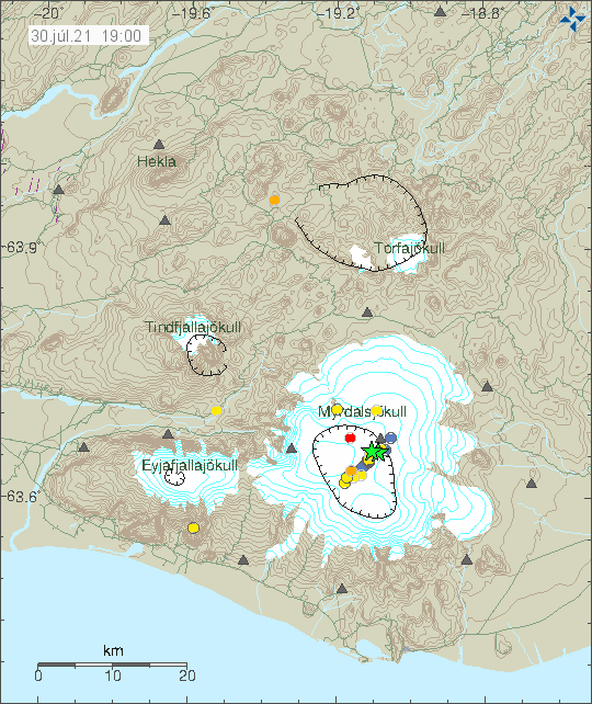 Cluster of smaller earthquakes in blue and red colours inside Katla volcano caldera. Two green stars on the north-east side of the caldera show the largest earthquakes.