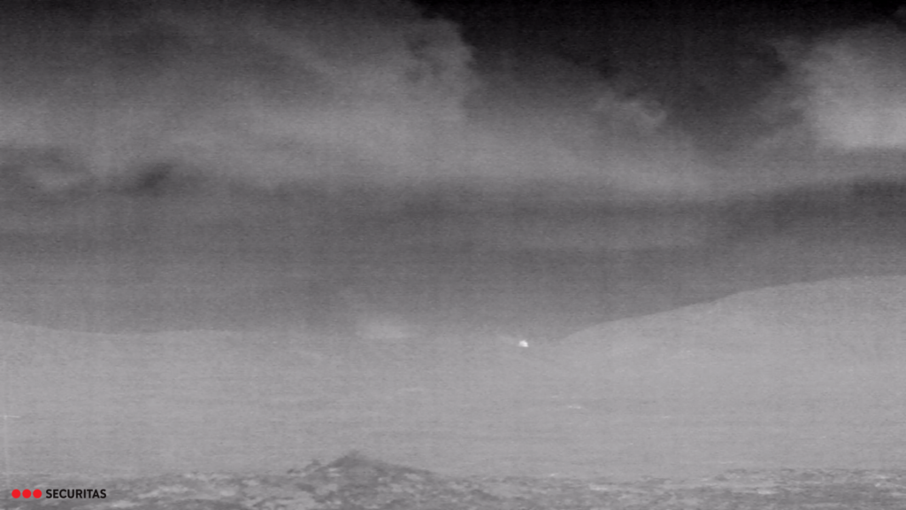 Thermal black and white image showing a bright spot on the centre of the image suggesting a strong heat source.